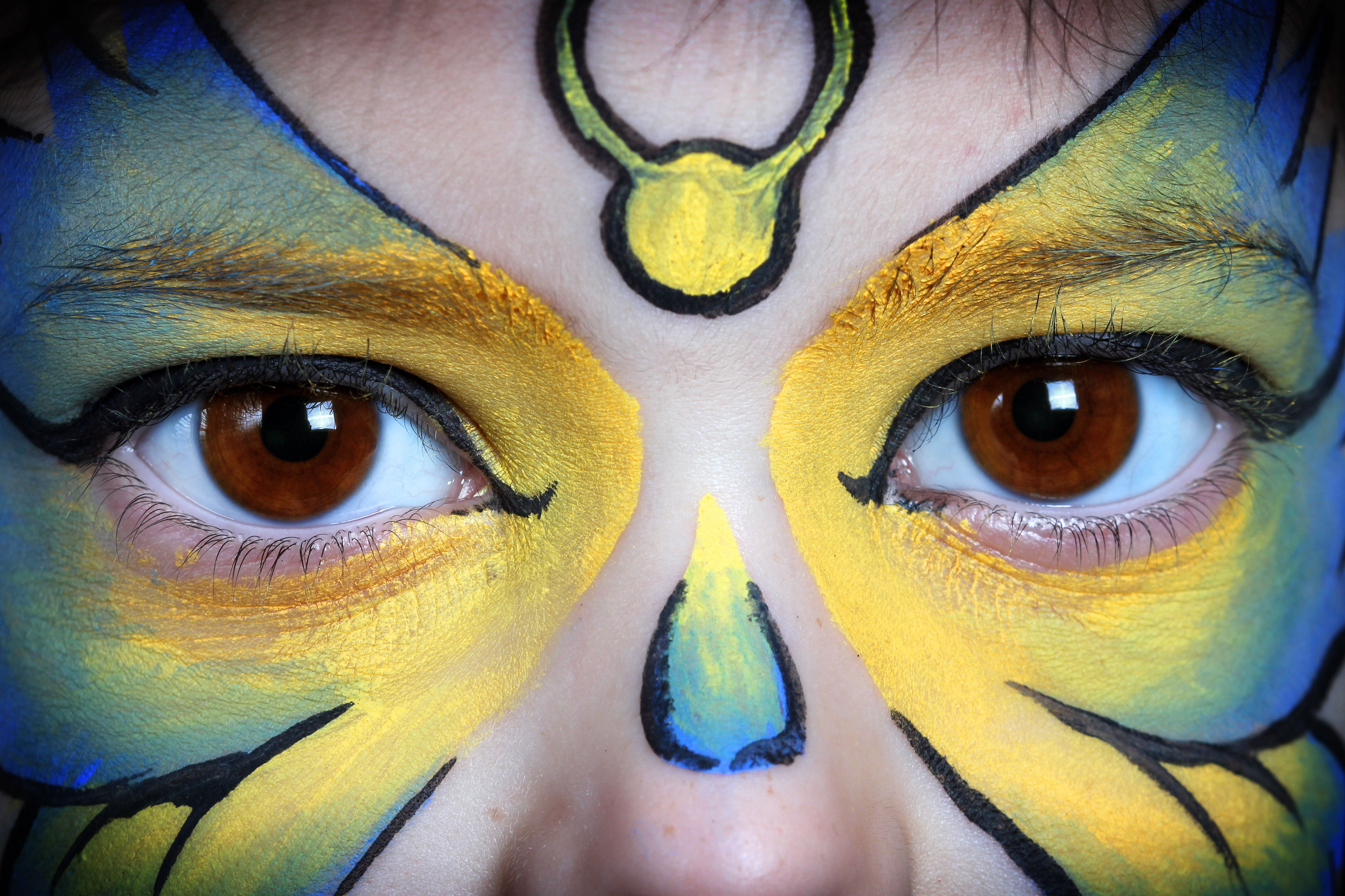 Blue and yellow butterfly face painting