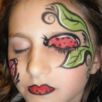 ladybug on a vine face painting